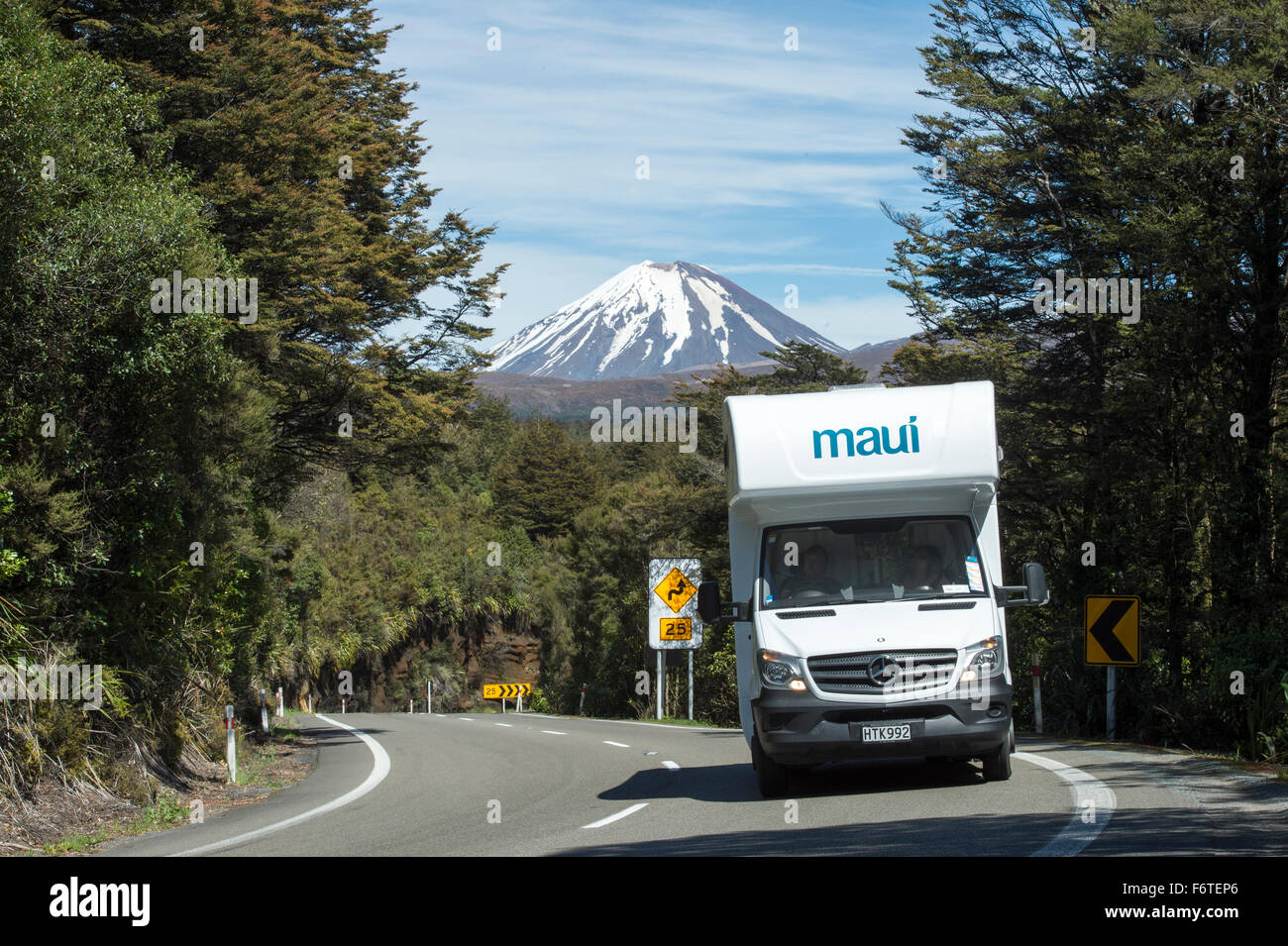 Maui Camper Van traveling along a windy part of the Dessert Road (SH1) in the middle of the North Island of New - Stock Image