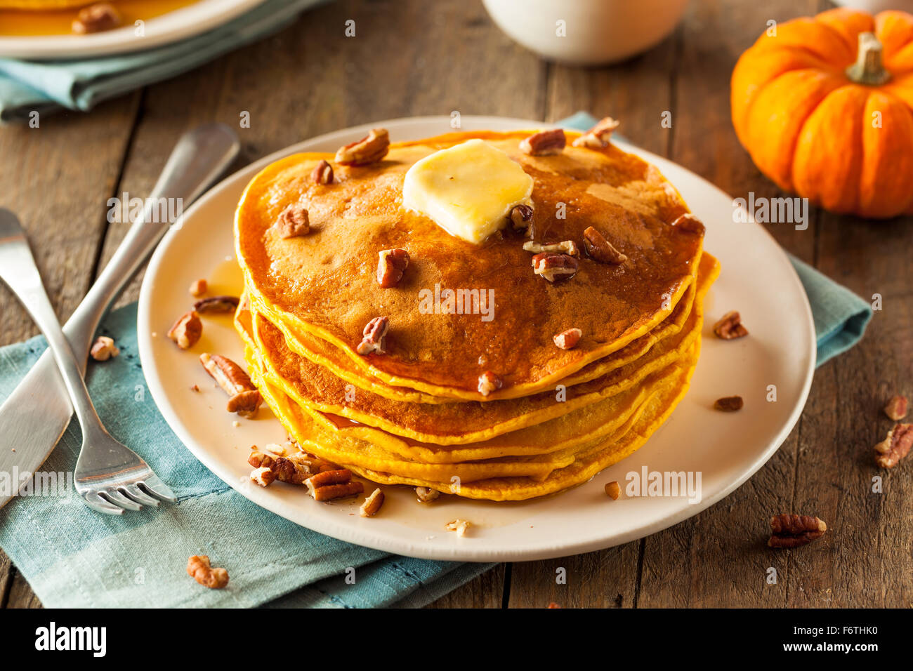 Homemade Pumpkin Pancakes with Butter Pecans and Maple Syrup - Stock Image