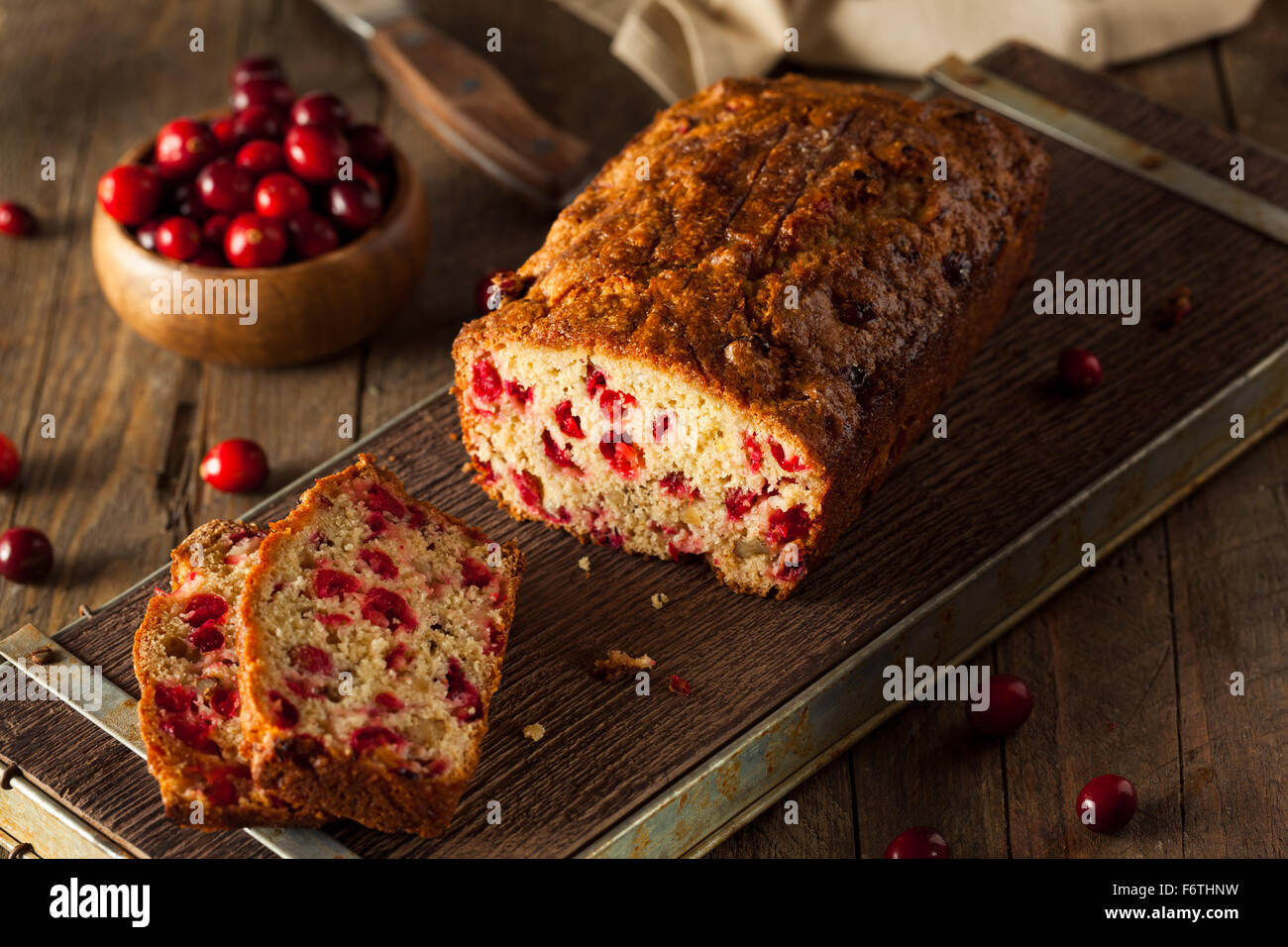 Hot Homemade Cranberry Bread Cut into Slices - Stock Image
