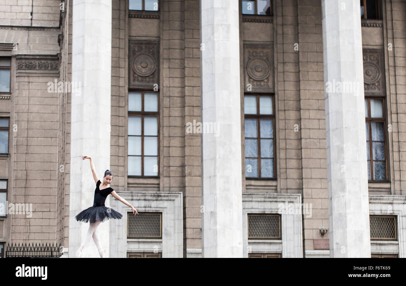 Girl ballerina flats standing on tiptoes on the street Stock Photo
