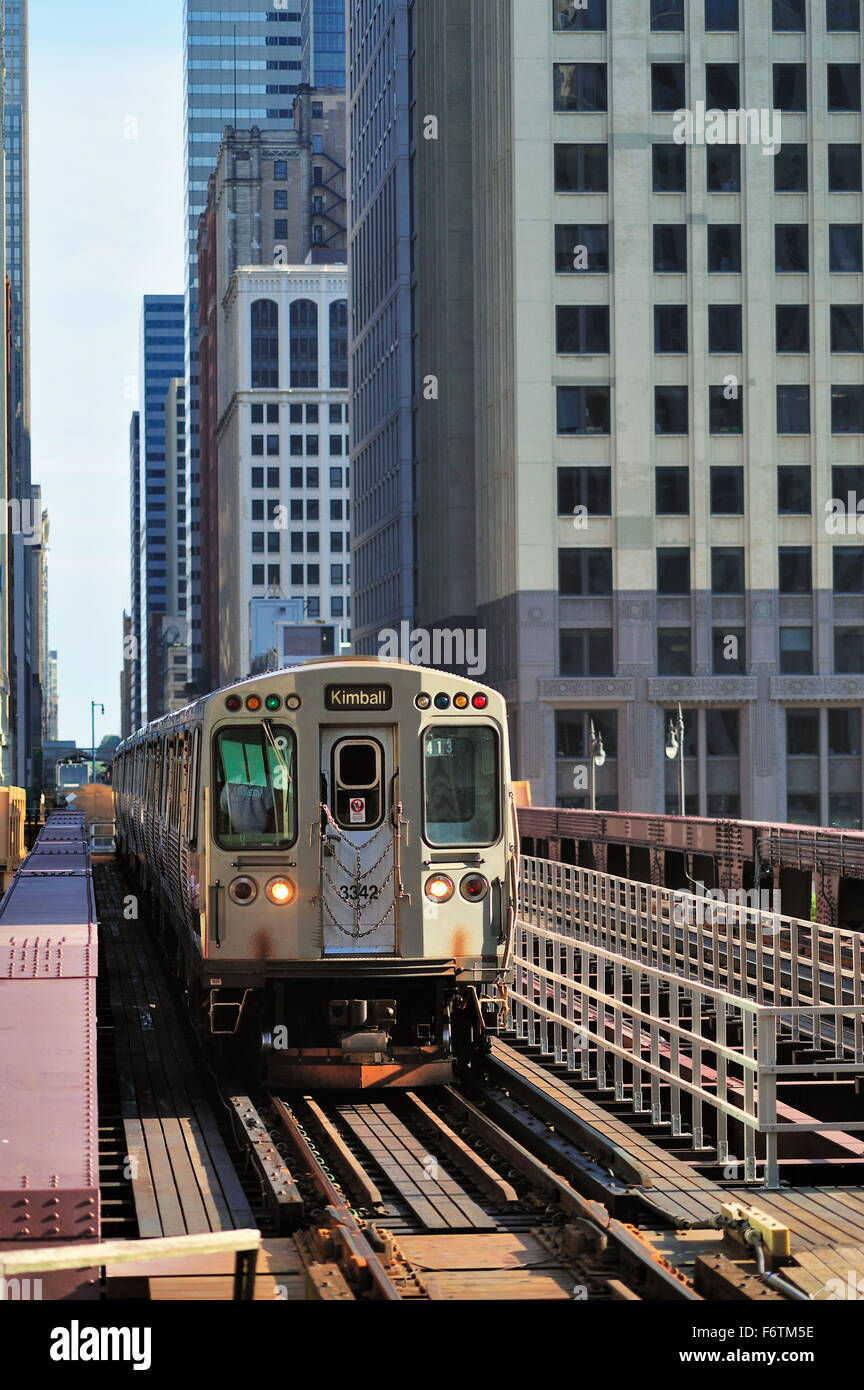 A CTA Brown Line rapid transit train crosses a bridge over the Chicago River as it leaves Chicago's famous Loop. - Stock Image