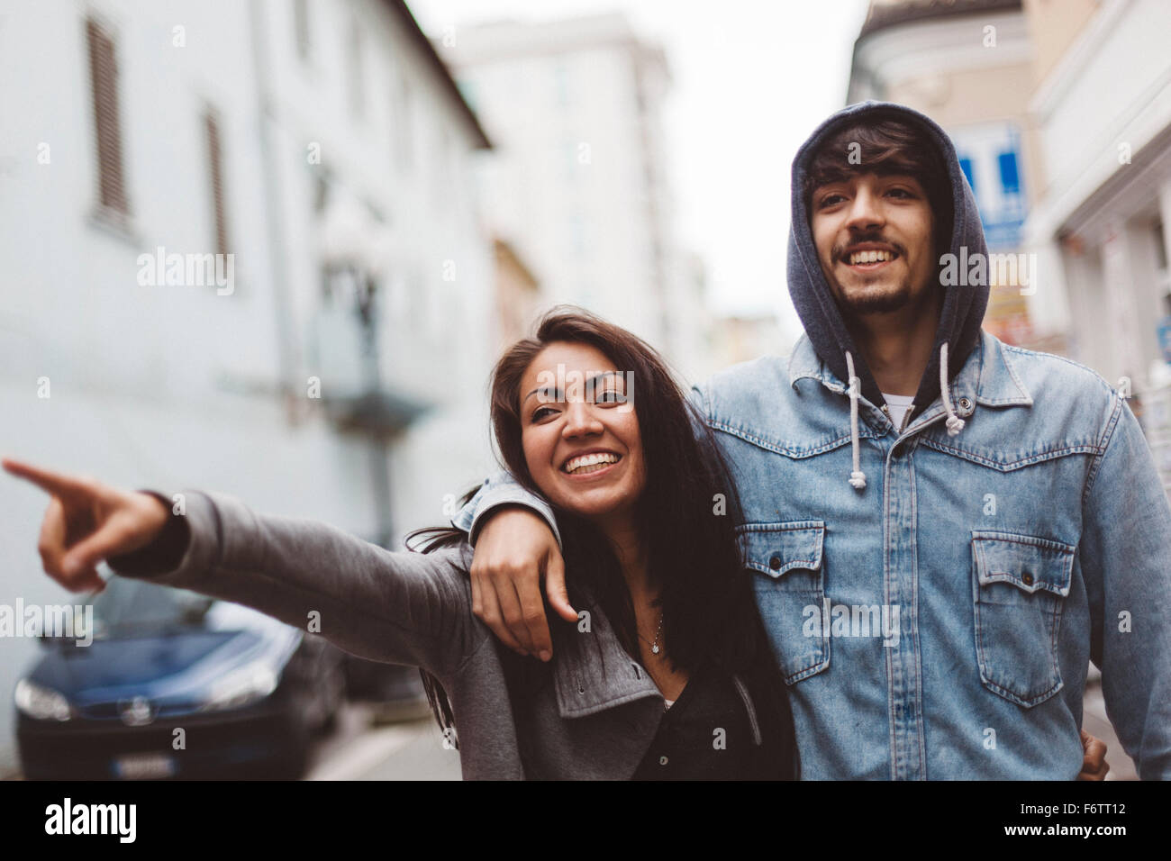 Italy, Rimini, smiling couple in the city - Stock Image