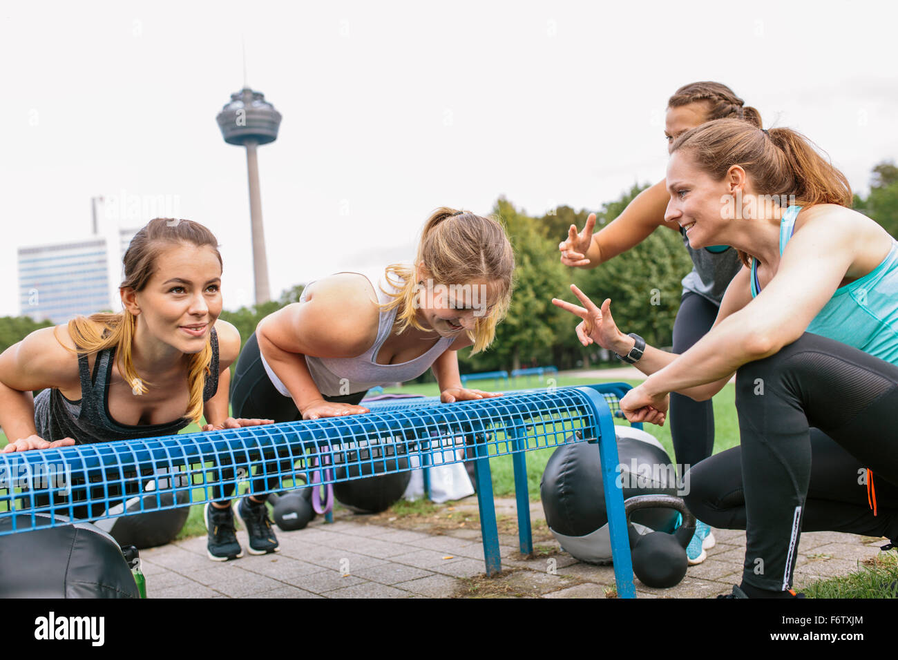 Four women having an outdoor boot camp workout Stock Photo