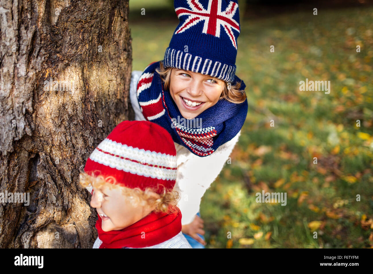Portrait of two blond boys wearing fashionable knit wear in autumn - Stock Image