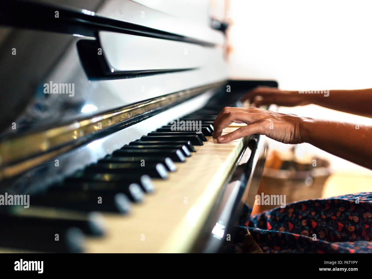 Close-up of woman playing piano - Stock Image
