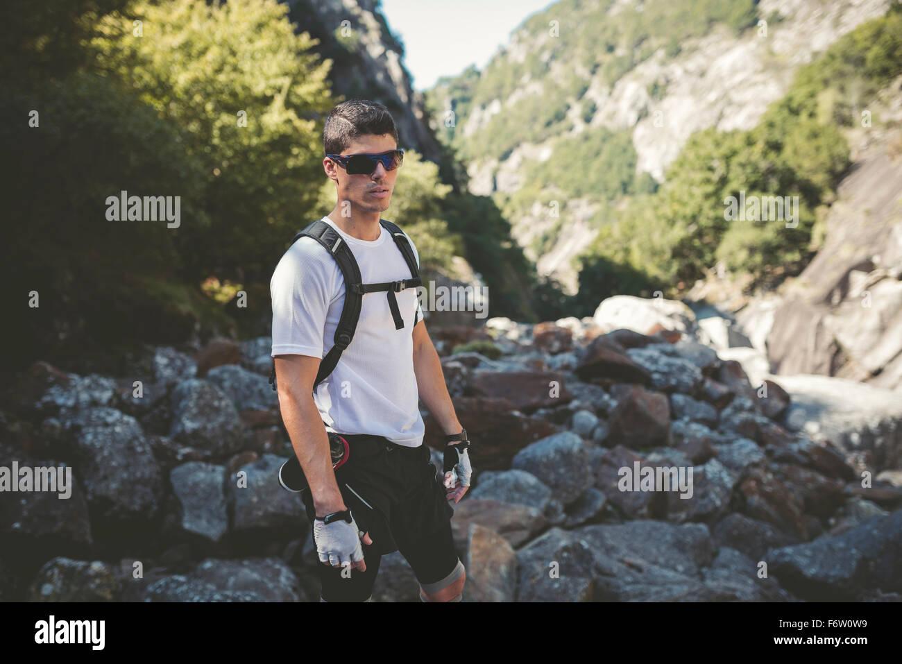 Ultra runner in mountains wearing sun glasses - Stock Image
