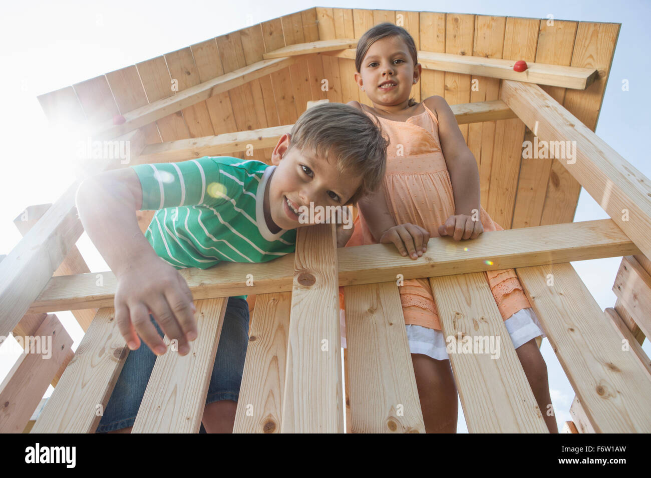 Brother and sister in a wendy house - Stock Image