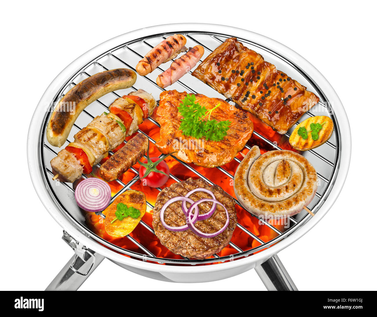 white kettle grill with grilled food - Stock Image