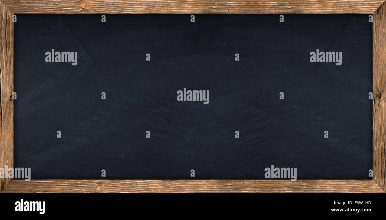 wide blackboard with wooden frame - Stock Image
