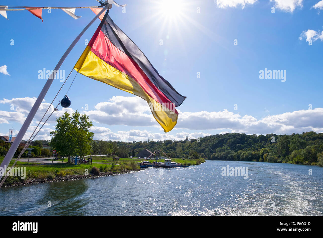 Germany, Lower Franconia, Germany flag on ferry near Volkach - Stock Image