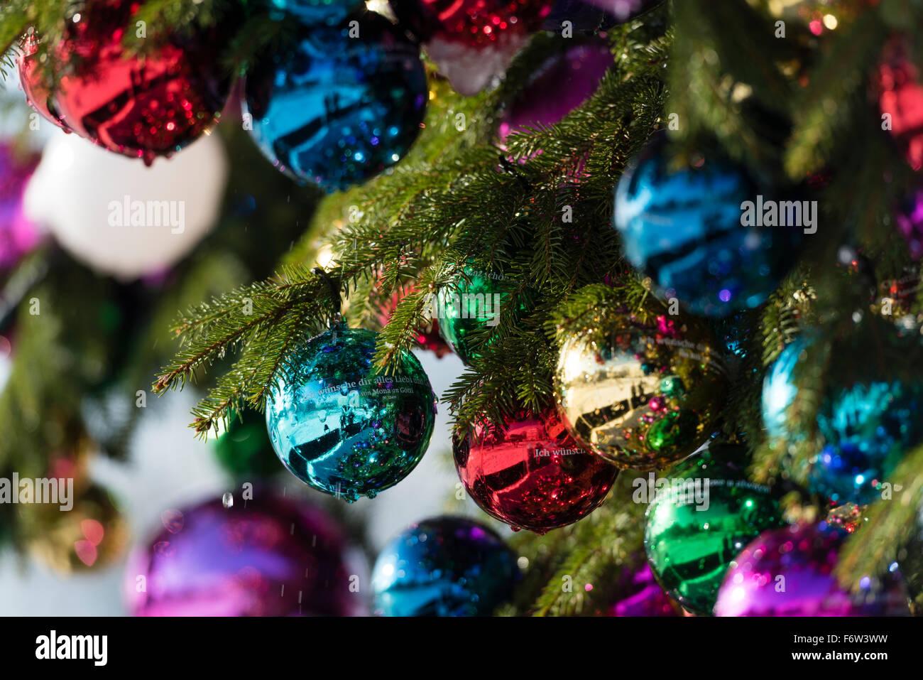 Colourful Christmas ball ornaments on a giant Christmas tree on Saechselaeutenplatz, outside Zurich Opera house, - Stock Image