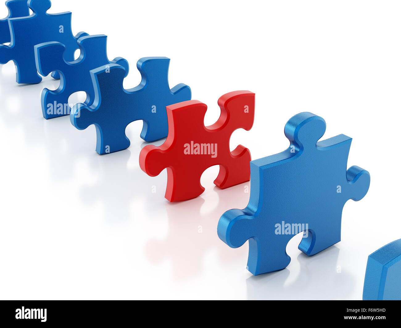 Red puzzle piece stands out among blue puzzle parts - Stock Image