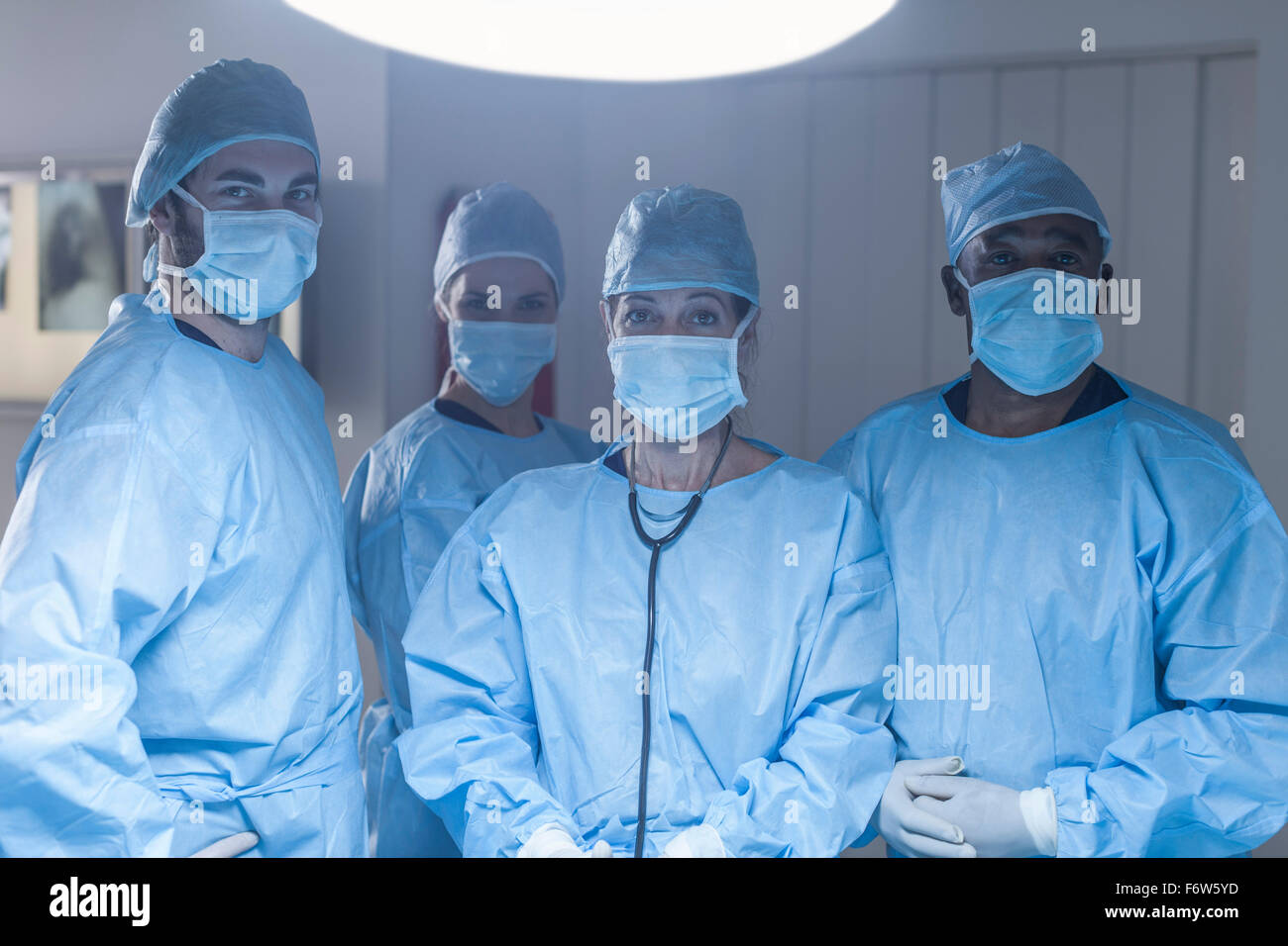 Portrait of surgical team wearing masks - Stock Image