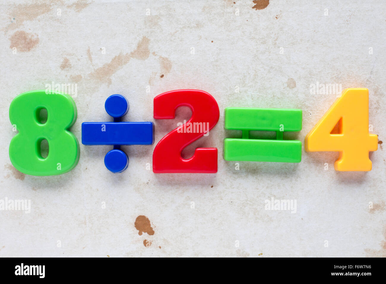 Simple math division formula on old paper background Stock Photo ...