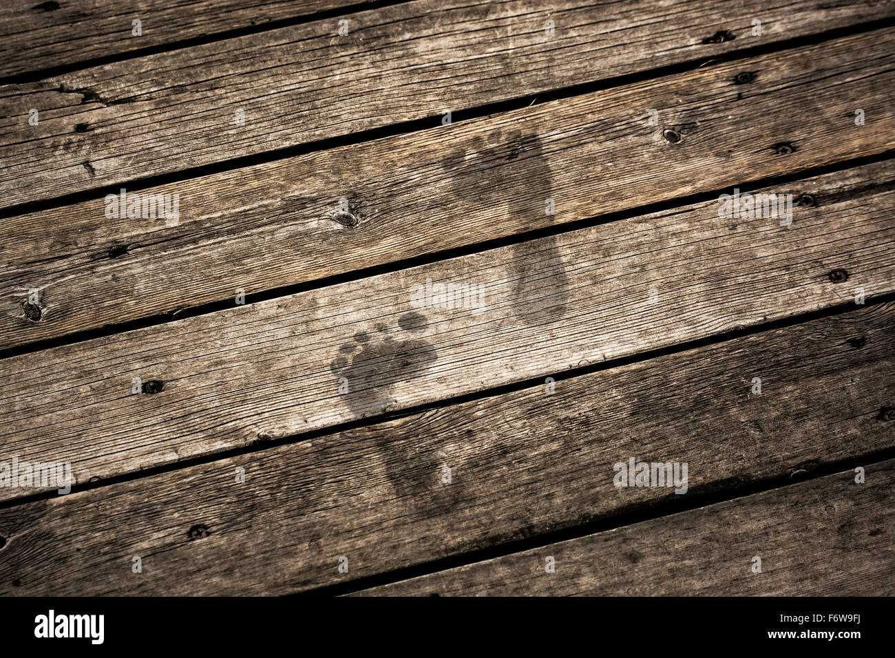 step forward on dusty floor - Stock Image
