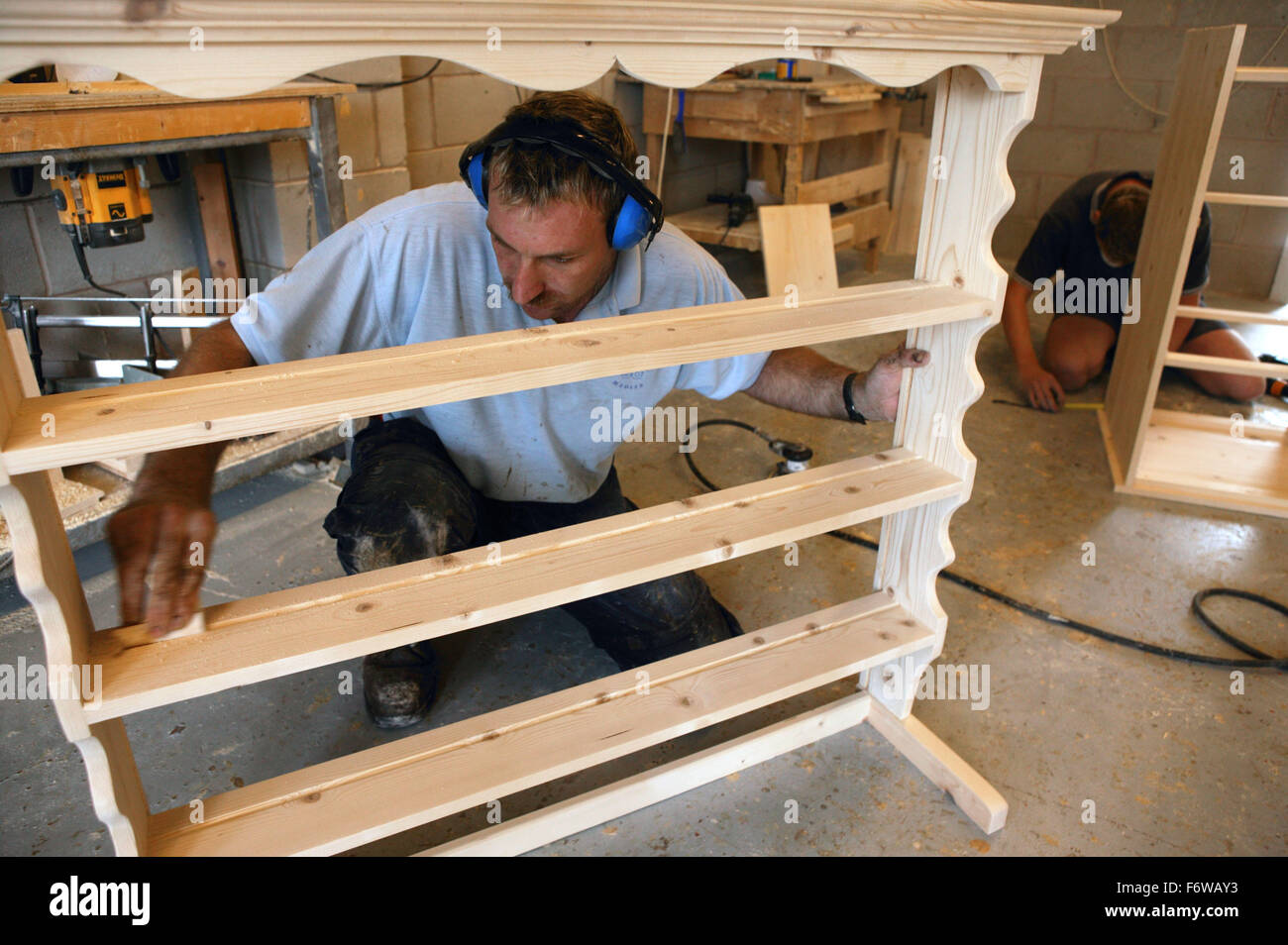 Man With Learning Disabilities Making Pine Furniture Stock
