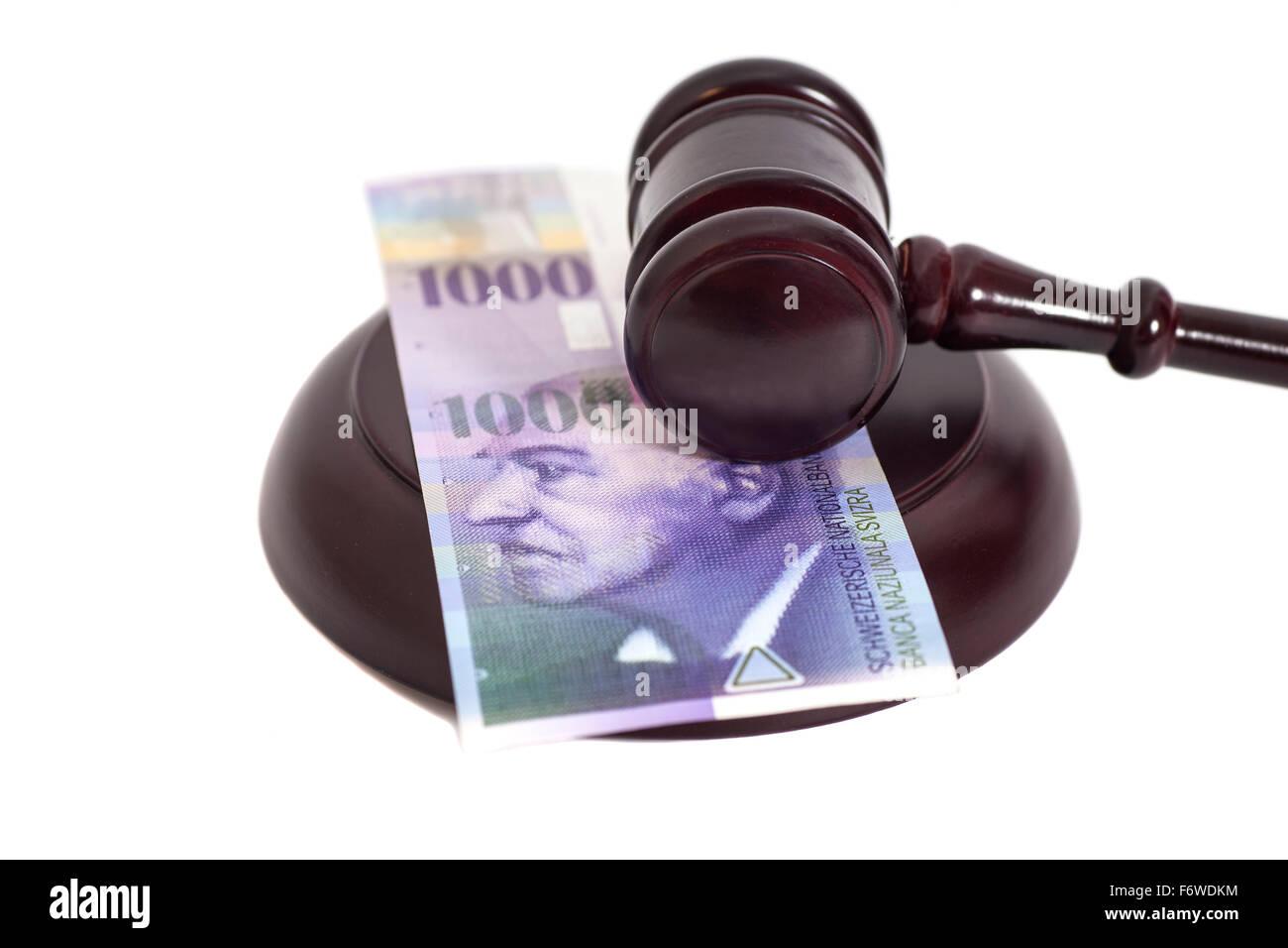 Judge Gavel and Swiss Thousand Franc Currency isolated Stock Photo
