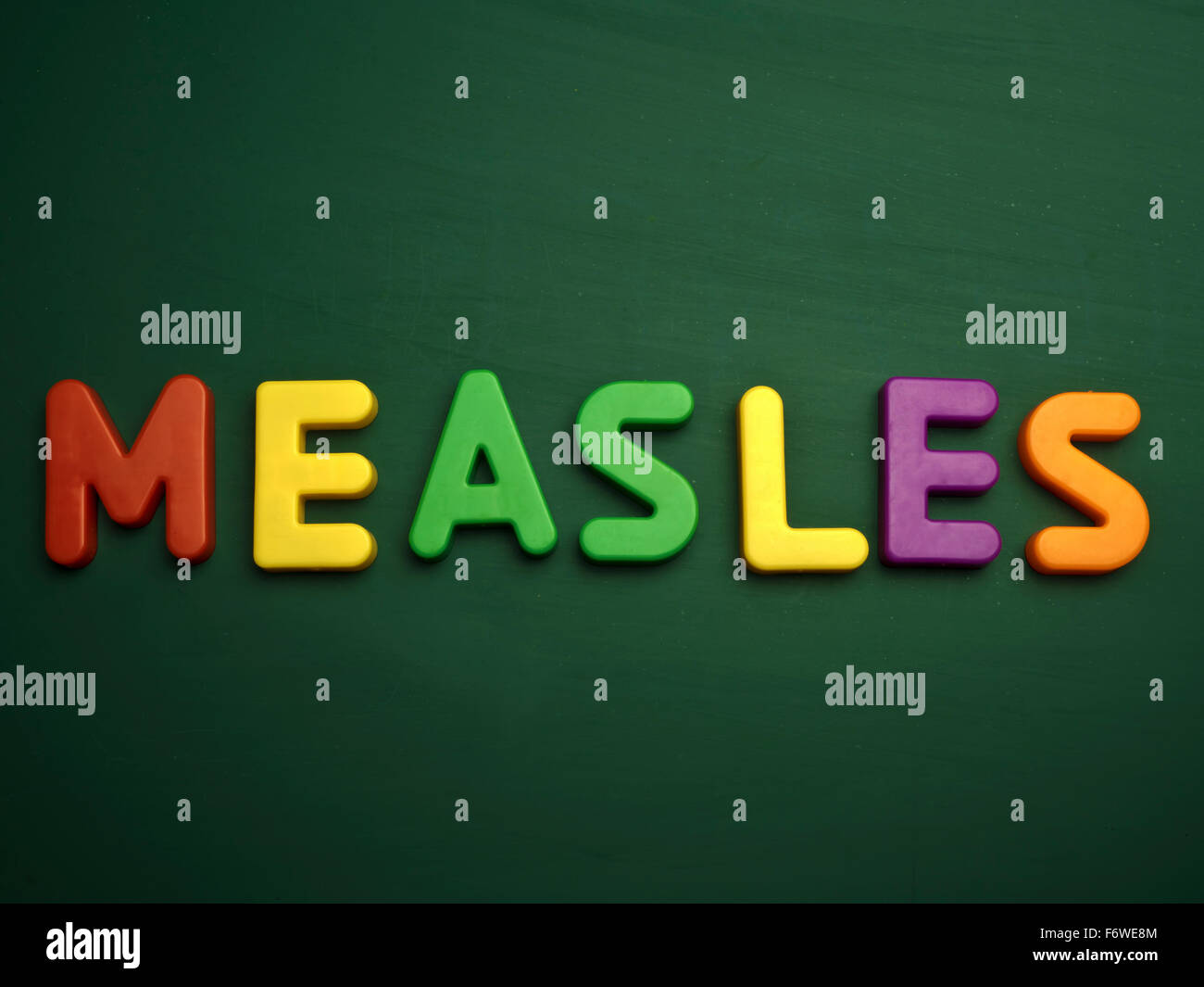measles concept in colorful letters isolated on blank blackboard - Stock Image