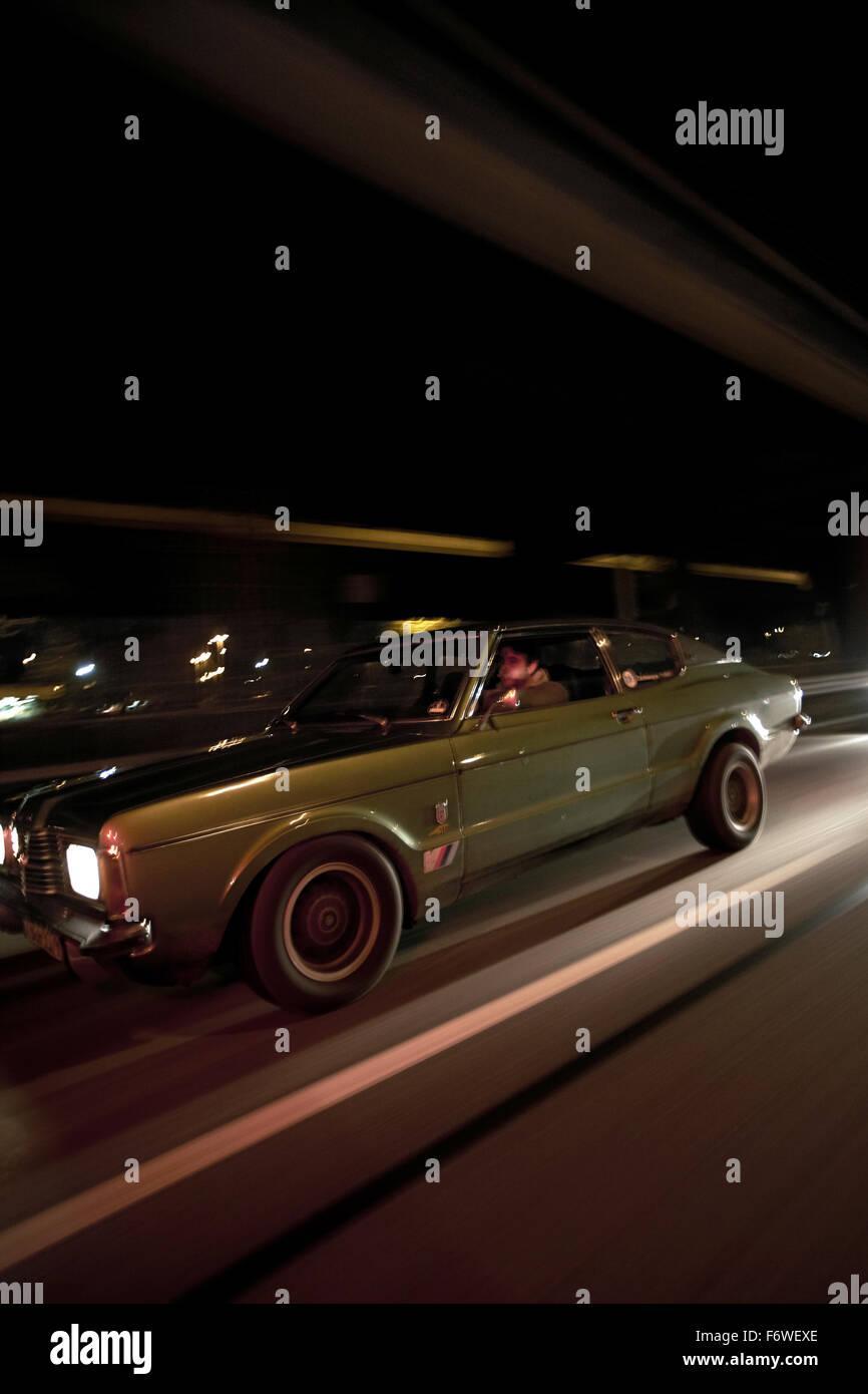 Man Driving A Modern Classic Car At Night Motoraver Group Hamburg
