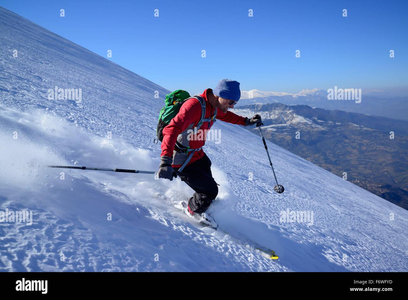 Backcountry skier downhill skiing, Monte Prena, Gran Sasso, Abruzzo, Italy - Stock Image