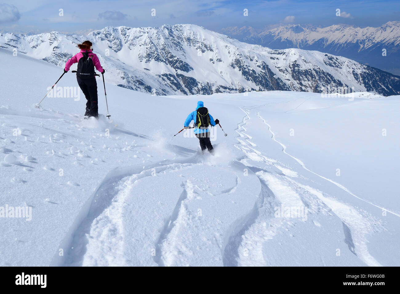 Two female backcountry skier downhill skiing, Malgrubler, Tux Alps, Tyrol, Austria - Stock Image