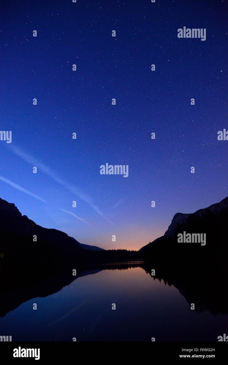 Night sky with stars above lake Tovel, lake Tovel, Brenta range, Brenta, Dolomites, UNESCO World Heritage Site Dolomites, - Stock Image