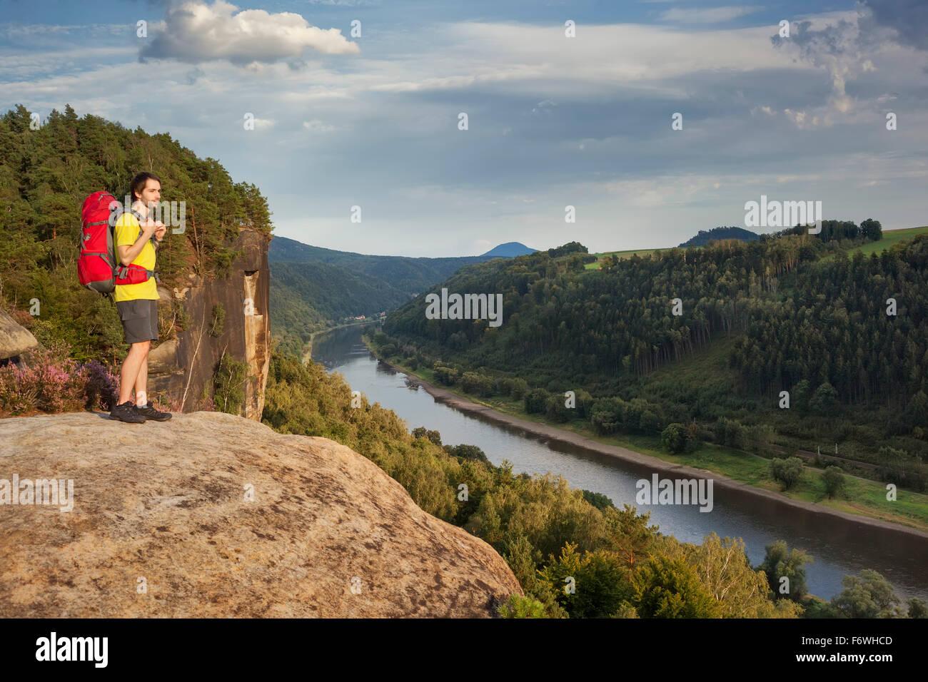 Young man enjoying view over river Elbe, Saxon Switzerland National Park, Saxony, Germany - Stock Image