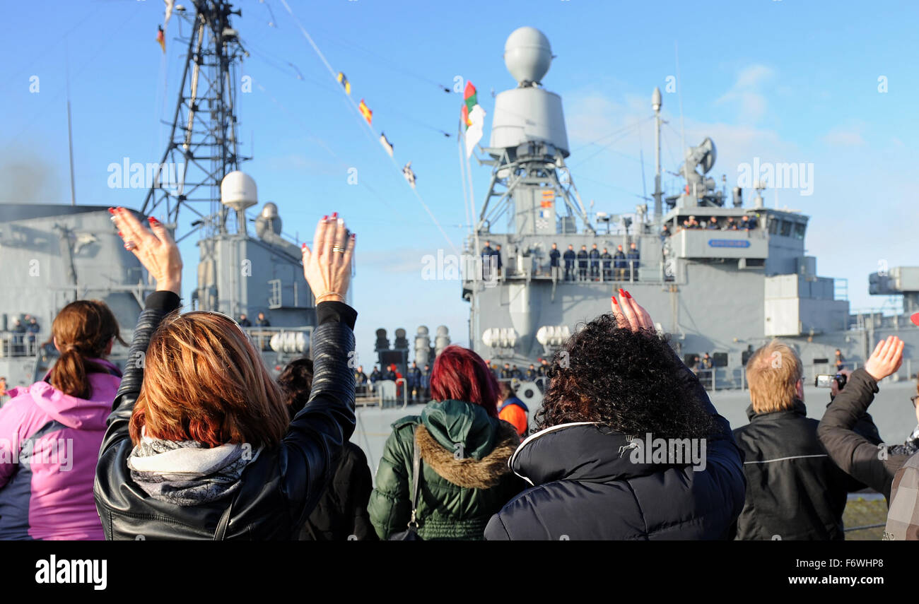 Relatives wave farewell to the members of the crew of Germany navy vessel 'Augsburg' in Wilhelmshaven, Germany, - Stock Image