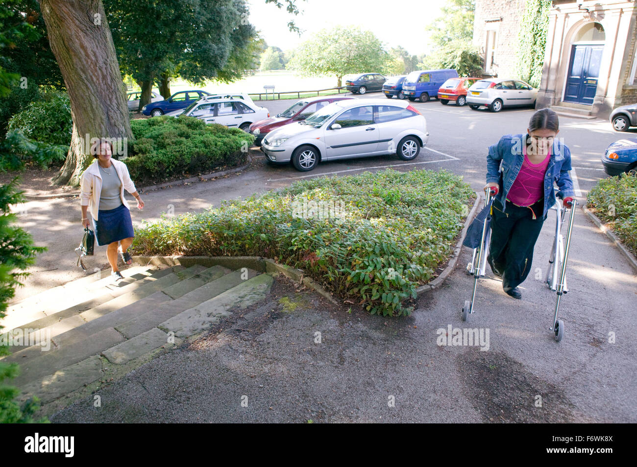 Different paths of access: conventional steps or a smooth ramp for easier access for people with physical disabilities, - Stock Image