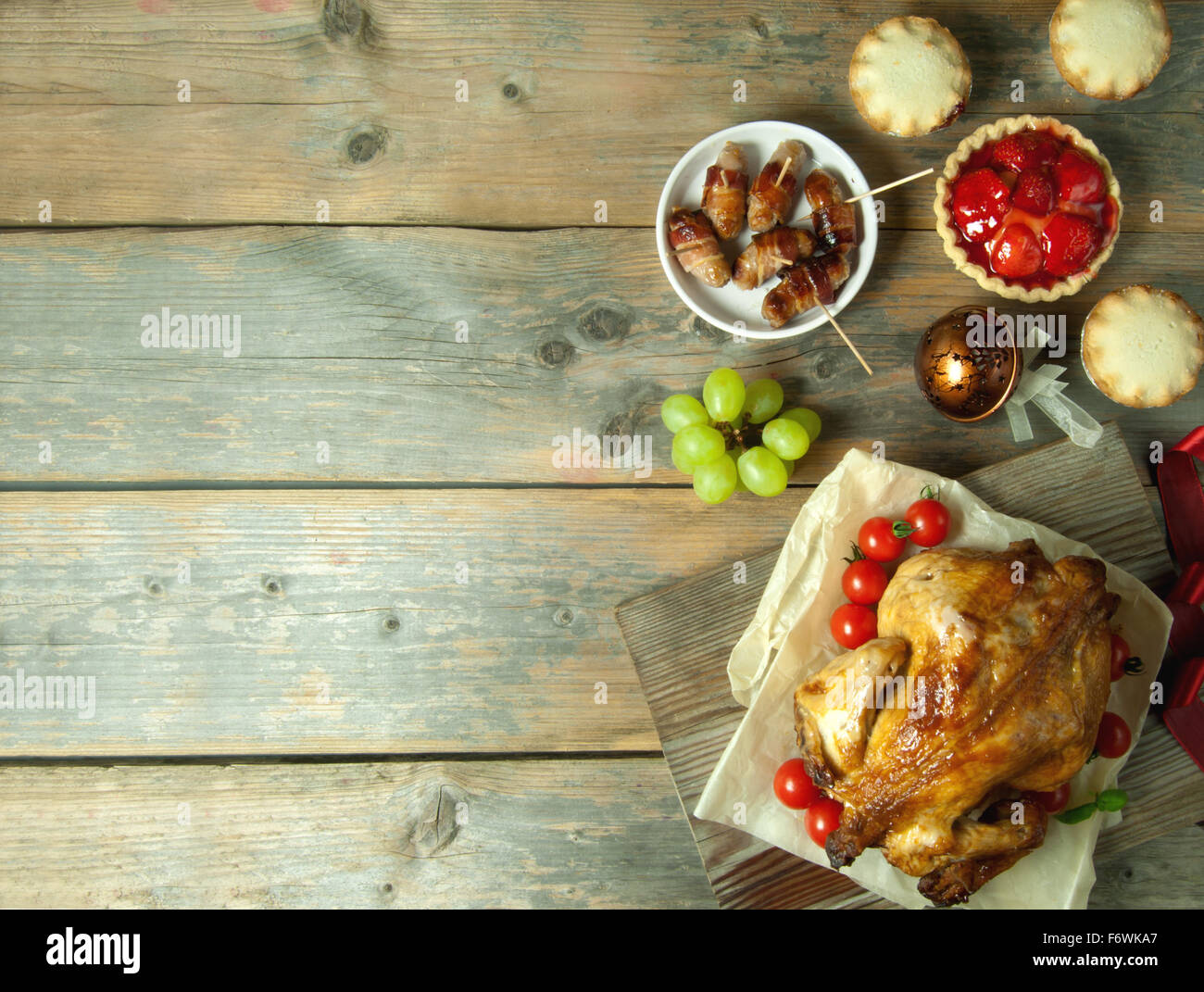 Christmas and thanksgiving savory and sweet food selection on top of a wooden background with copyspace - Stock Image