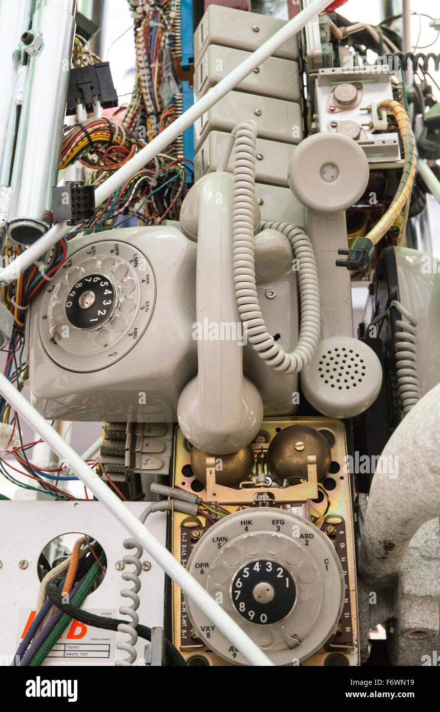 Chaotic set old telephone and communication equipment - Stock Image