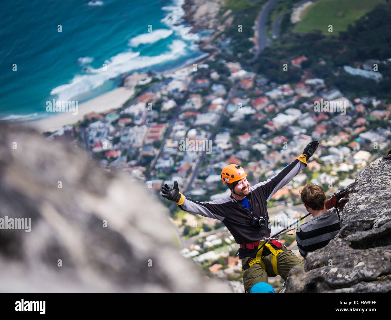 Man abseiling from Table Mountain, Camps Bay, Cape Town, Western Cape, South Africa Stock Photo