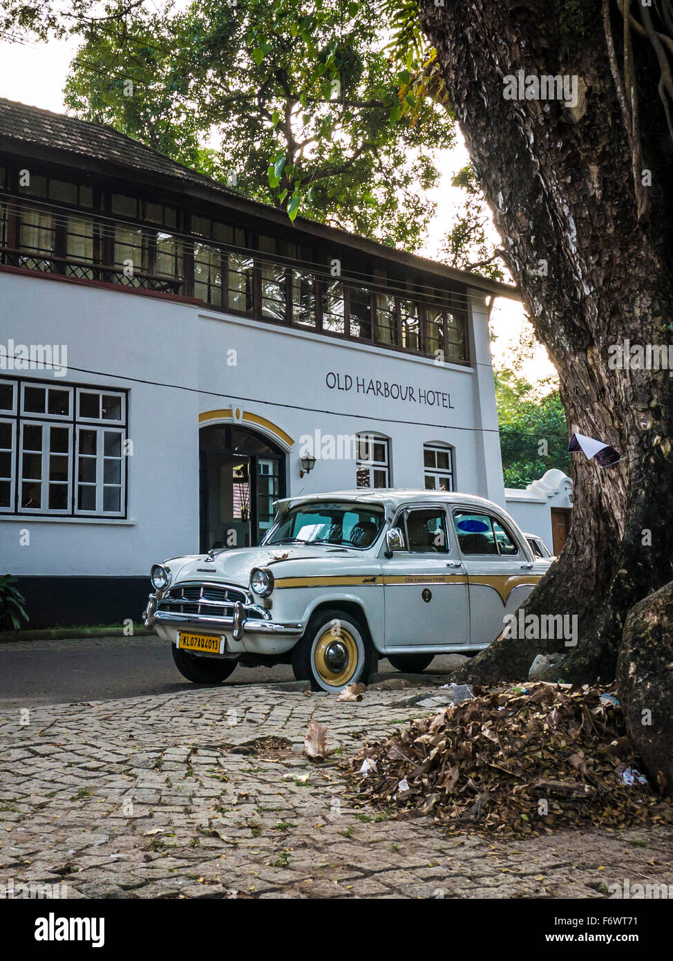 An Ambassador car in front of a hotel, Kochi, Kerala, India - Stock Image