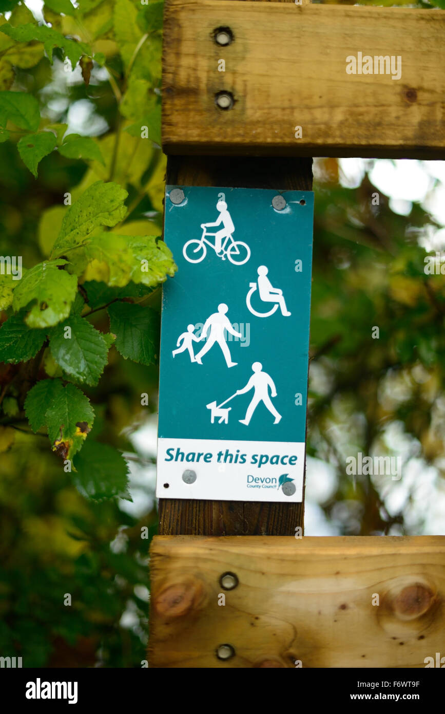 'Share this space' sign along a communal path. - Stock Image