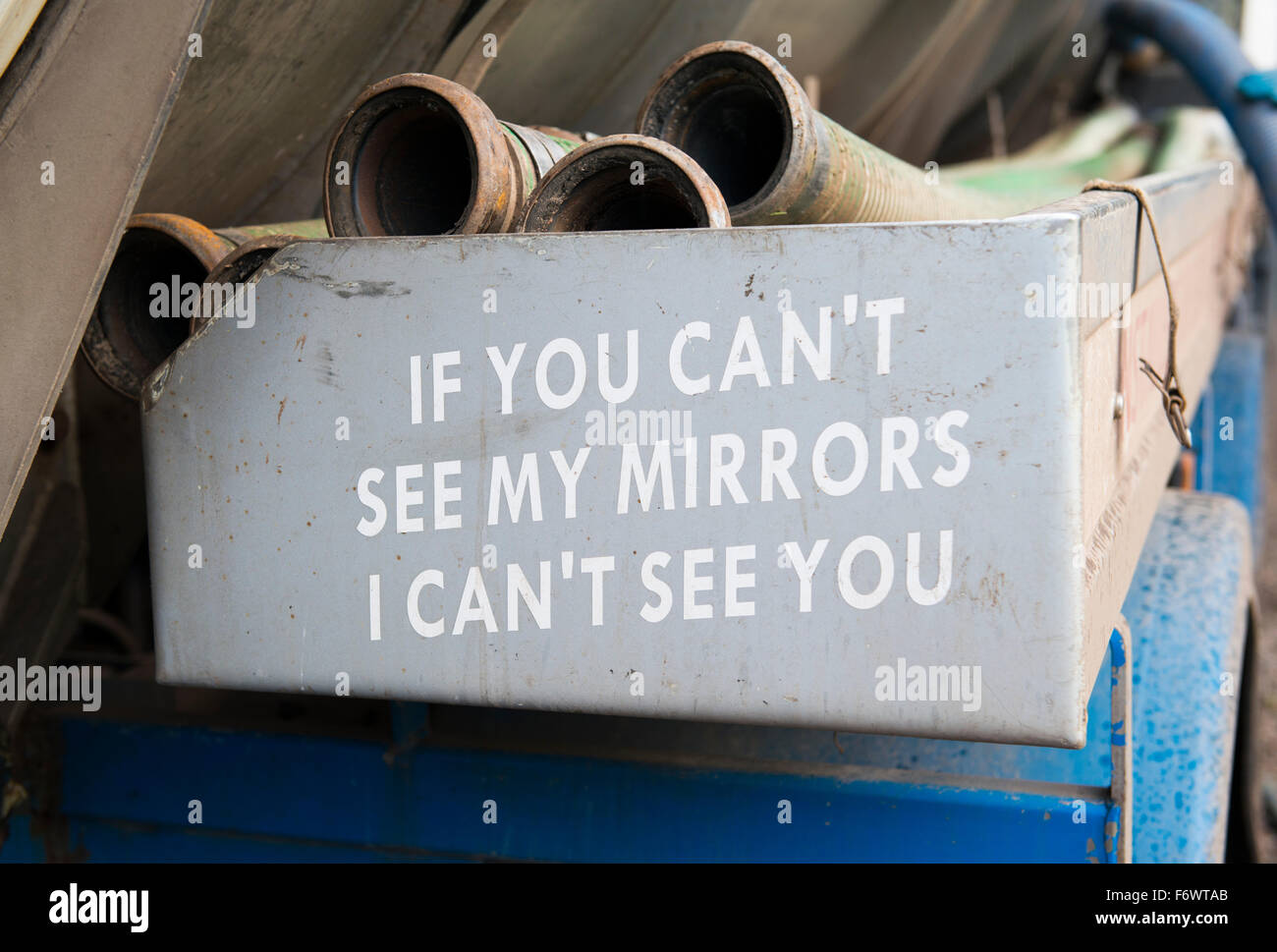 'If you can't see my mirrors I can't see you' road safety warning sign on the back of a lorry. - Stock Image