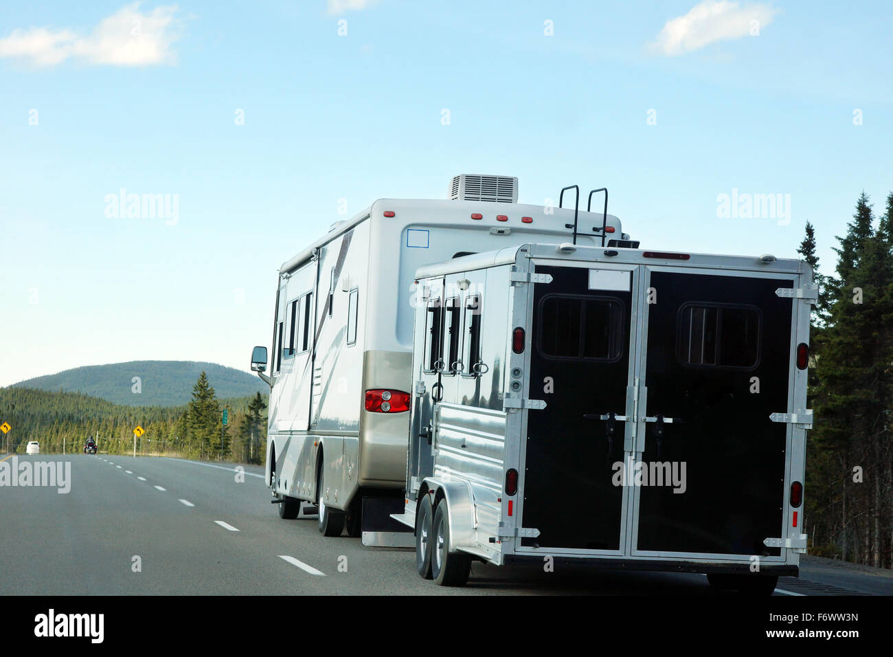 RV or motor home with trailer on the road, vacation and summer concept - Stock Image