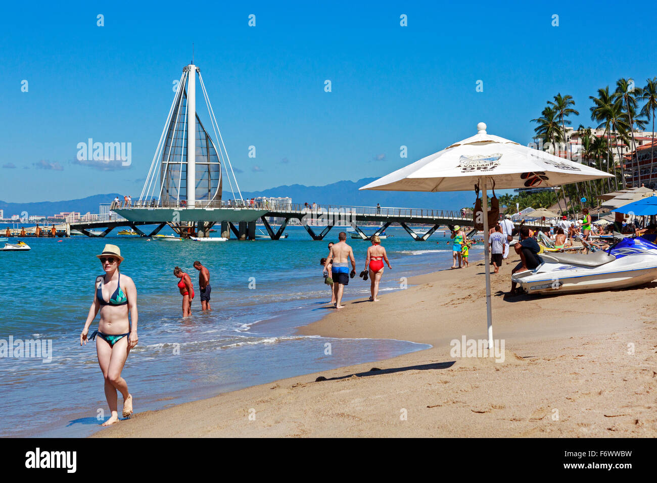 Beach at Zona Romantica, old town of Puerto Vallarta, Mexico with the Los Muertos Pier in the background Stock Photo