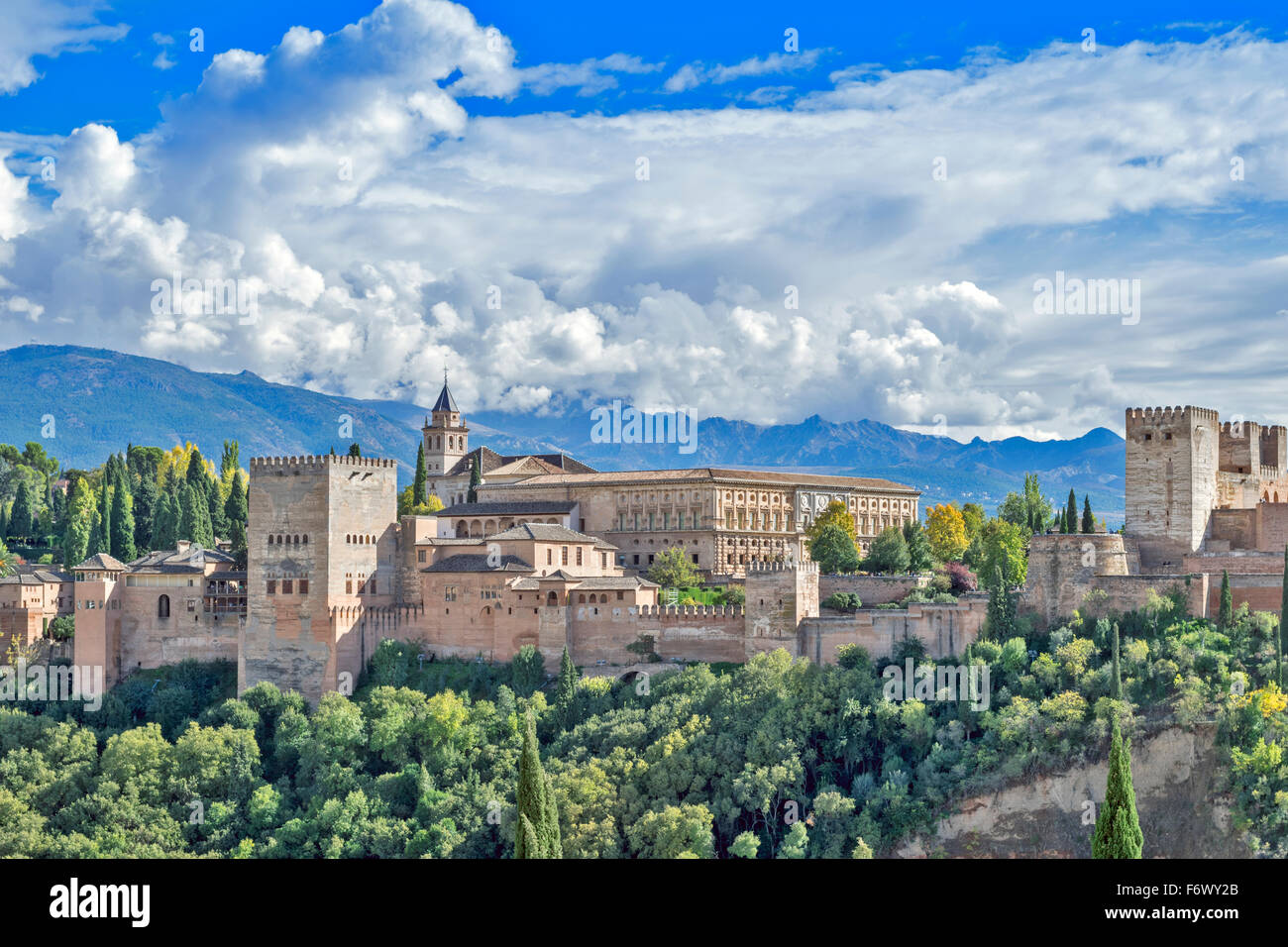 GRANADA ANDALUCIA SPAIN THE ALHAMBRA WITH STORM CLOUDS OVER THE SIERRA NEVADA - Stock Image