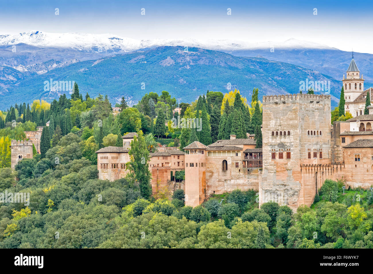 GRANADA SPAIN THE ALHAMBRA A MOORISH CITADEL AND PALACE  AUTUMN TREES AND SNOW ON THE SIERRA NEVADA MOUNTAINS - Stock Image