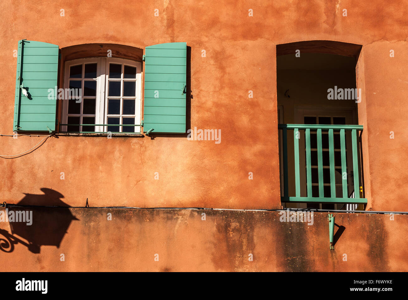 Sunbaked building detail window and balcony - Stock Image