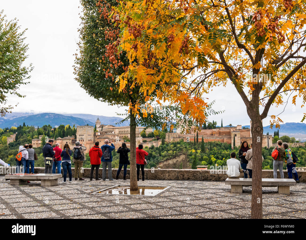 GRANADA SPAIN THE ALHAMBRA A MOORISH CITADEL AND PALACE  TOURISTS ON THE VIEWING POINT AND SNOW ON THE SIERRA NEVADA Stock Photo
