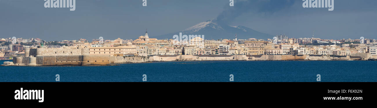 Cityscape of Sycracuse with Etna in the background, Sicily, Italy - Stock Image