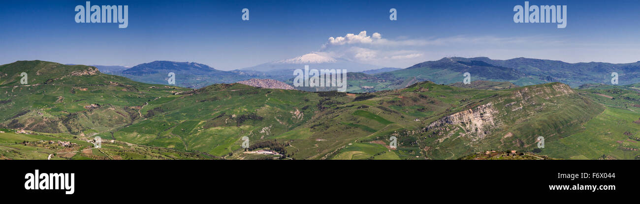 Panorama of the sicilian hillscape with smoking Etna in the background, Italy - Stock Image