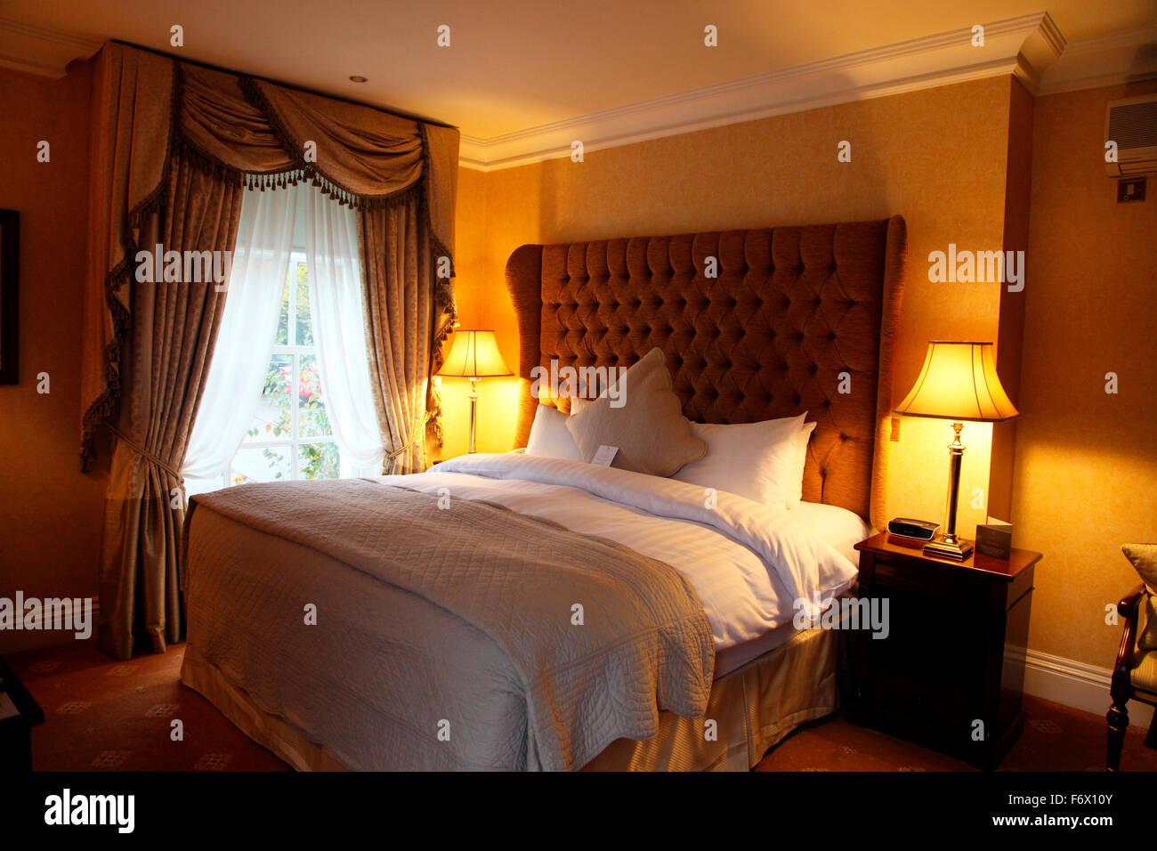 Bedroom in Hayfield Manor, now a luxury hotel - Stock Image
