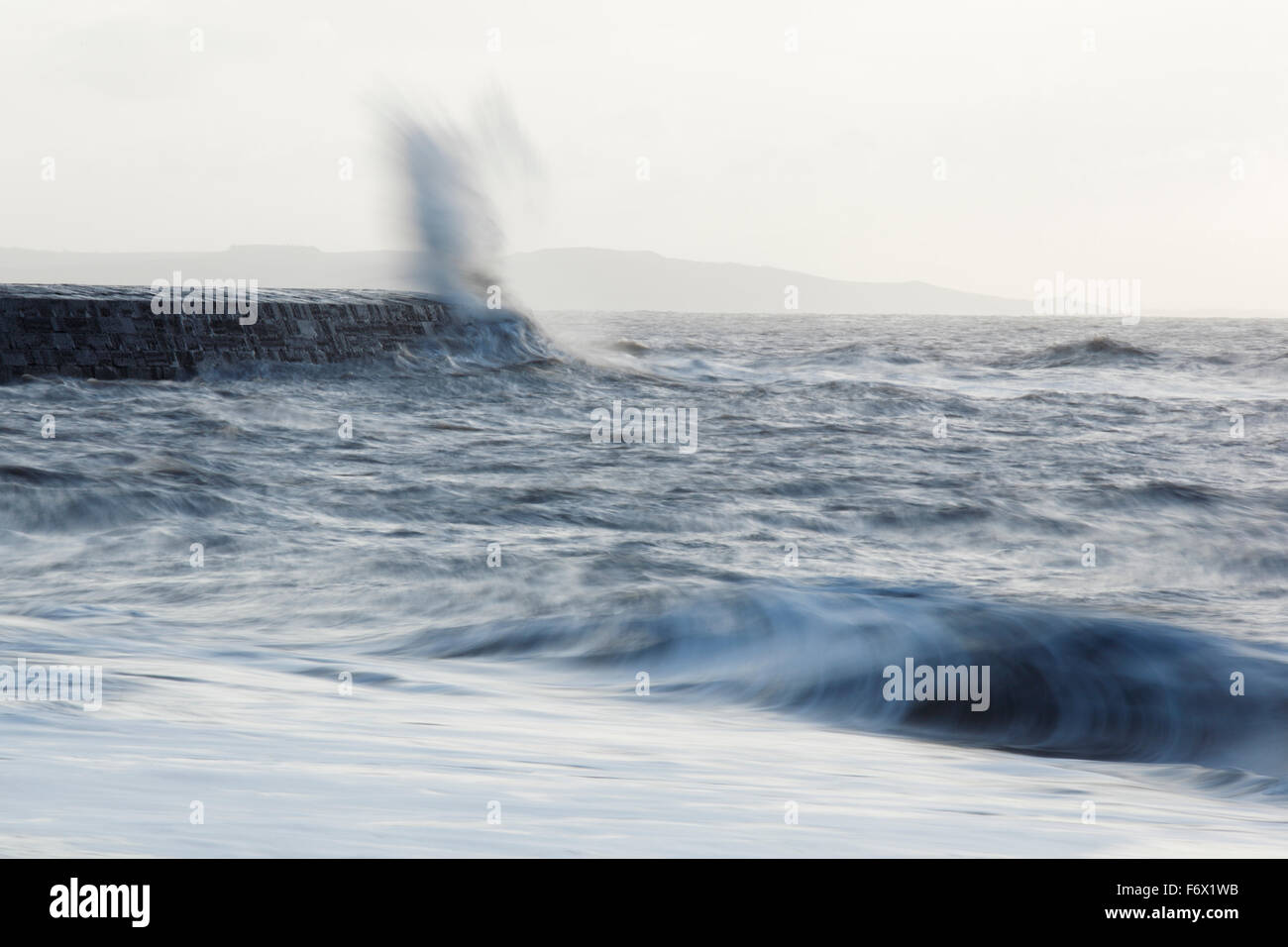 Rough seas crashing against The Cobb harbour wall. Lyme Regis. Dorset. UK. - Stock Image