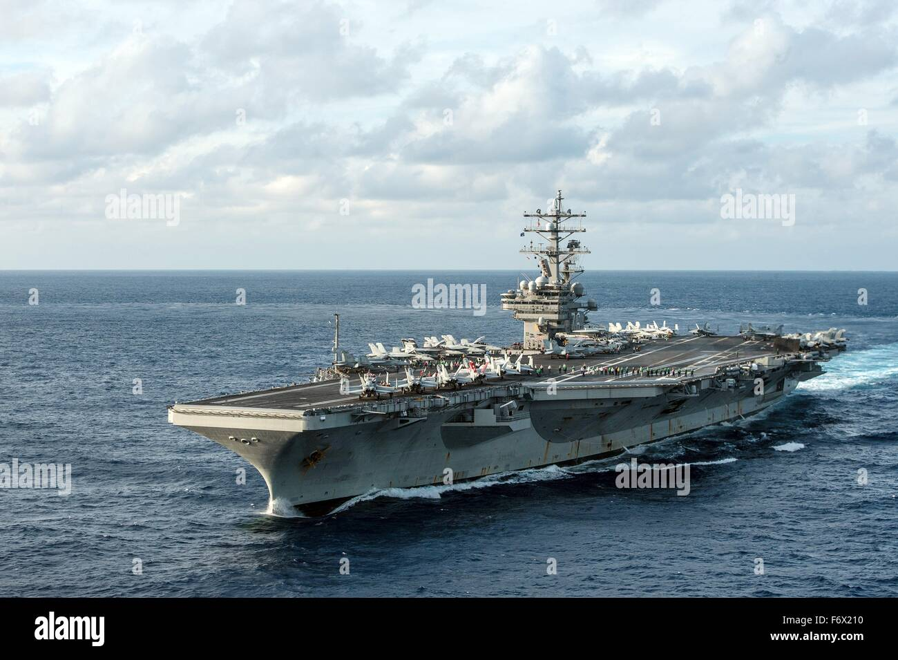 US Navy Nimitz-class aircraft carrier USS Ronald Reagan transits the Philippine Sea November 15, 2015 off the Philippine - Stock Image