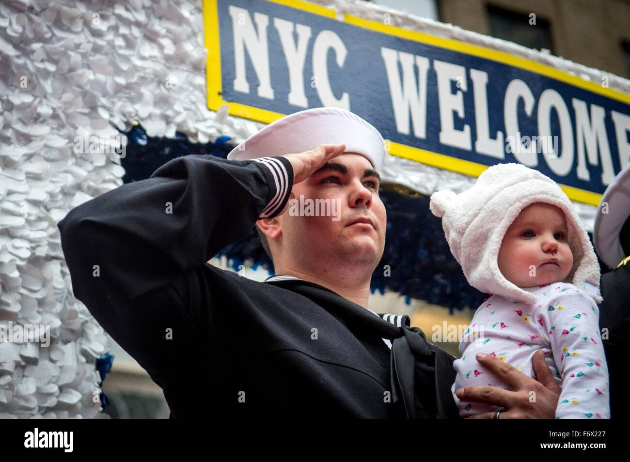 U.S. Navy sailor Petty Officer Collin Gomez salutes during the annual Veterans Day parade during Veterans Week activities November 11, 2015 in New York City, NY. Stock Photo