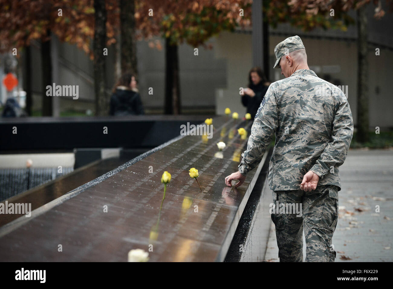 Members of the U.S. military Enlisted Field Advisory Council visit the Ground Zero Memorial in honor of Veterans Stock Photo