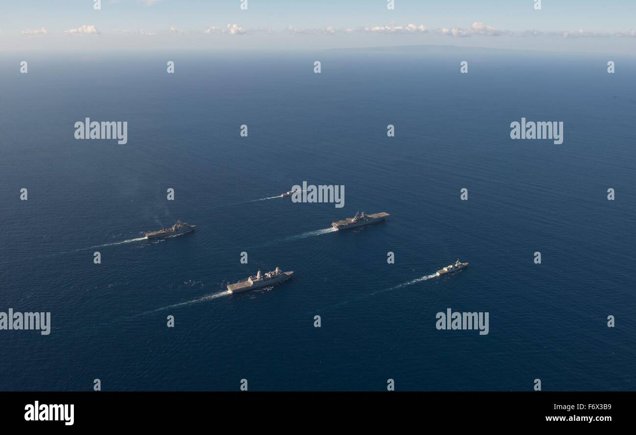 US Navy amphibious assault ship USS Boxer steams in formation along with the amphibious transport dock ship USS Stock Photo