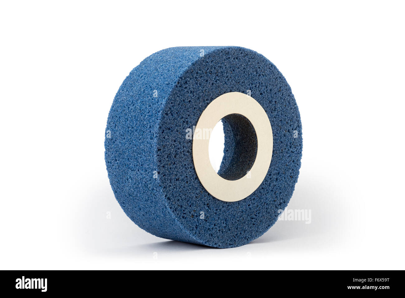 A blue abrasive wheel made out of corundum for a grinder, photographed in the studio on a white background. Grinding - Stock Image